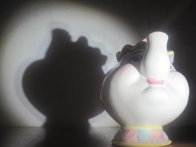 Grannie has lots of tea pots. This is one from the Mad hatters tea party in Alice in Wonderland. We lit it up with the torch to make it's shadow behind.
